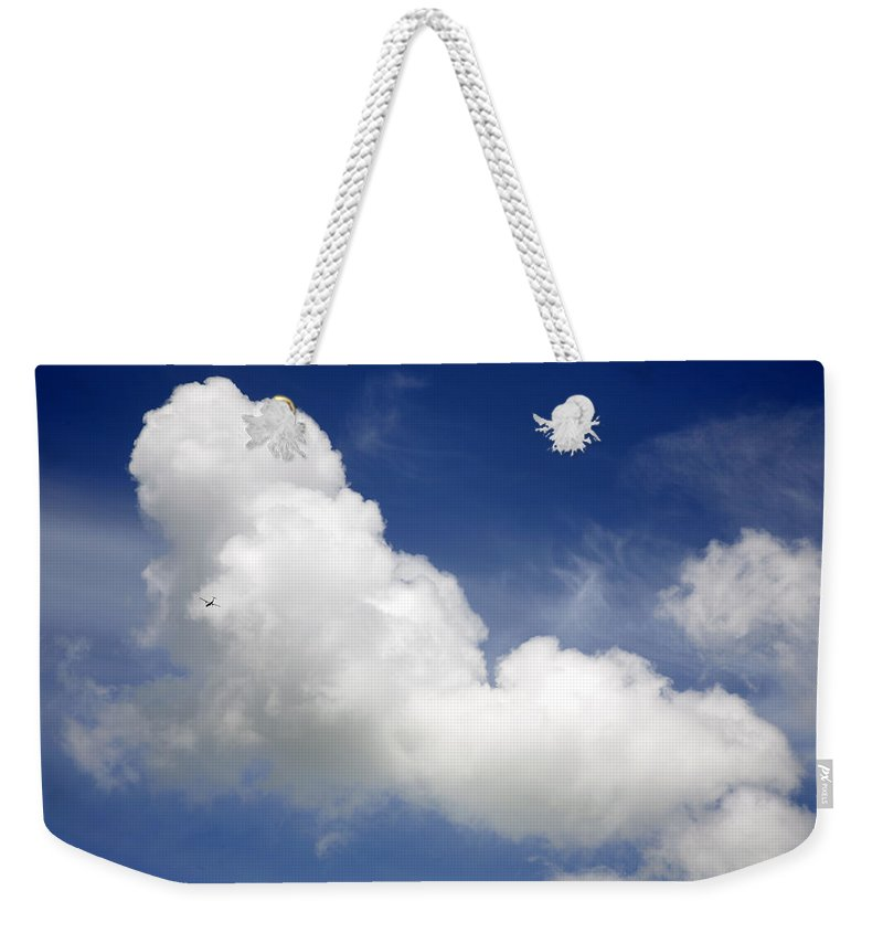Air Weekender Tote Bag featuring the photograph The Plane by Les Cunliffe