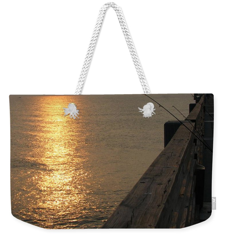 Art For The Wall...patzer Photography Weekender Tote Bag featuring the photograph The Pole by Greg Patzer
