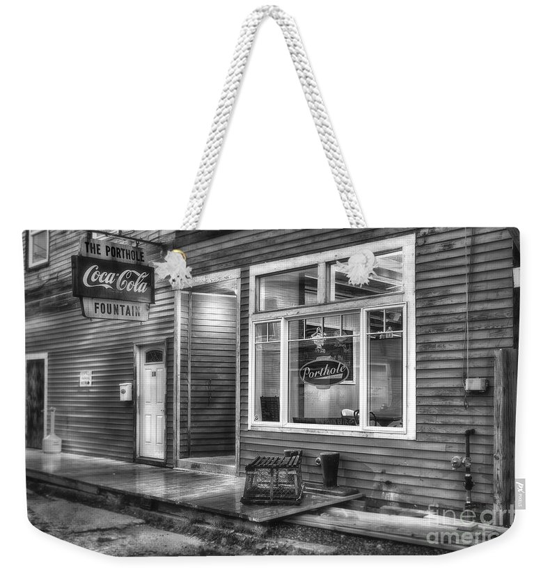Maine Weekender Tote Bag featuring the photograph The Porthole by Jerry Fornarotto