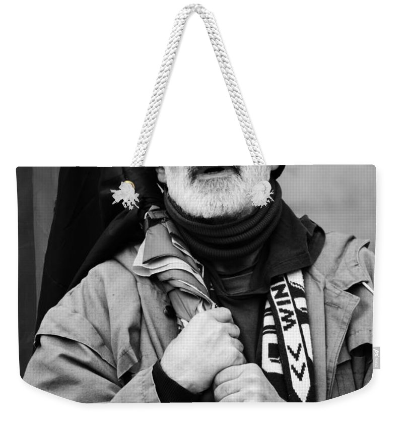 Street Photography Weekender Tote Bag featuring the photograph The Protester by The Artist Project