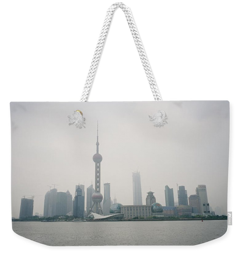 Shanghai Skyline Weekender Tote Bag featuring the photograph The Pudong by Shaun Higson