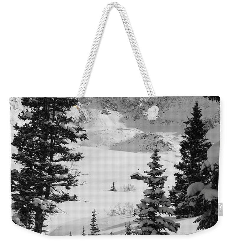Colorado Weekender Tote Bag featuring the photograph The Quiet Season by Eric Glaser