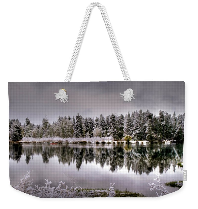 Oxbow Bend Weekender Tote Bag featuring the photograph The Red Canoe by Donna Kennedy