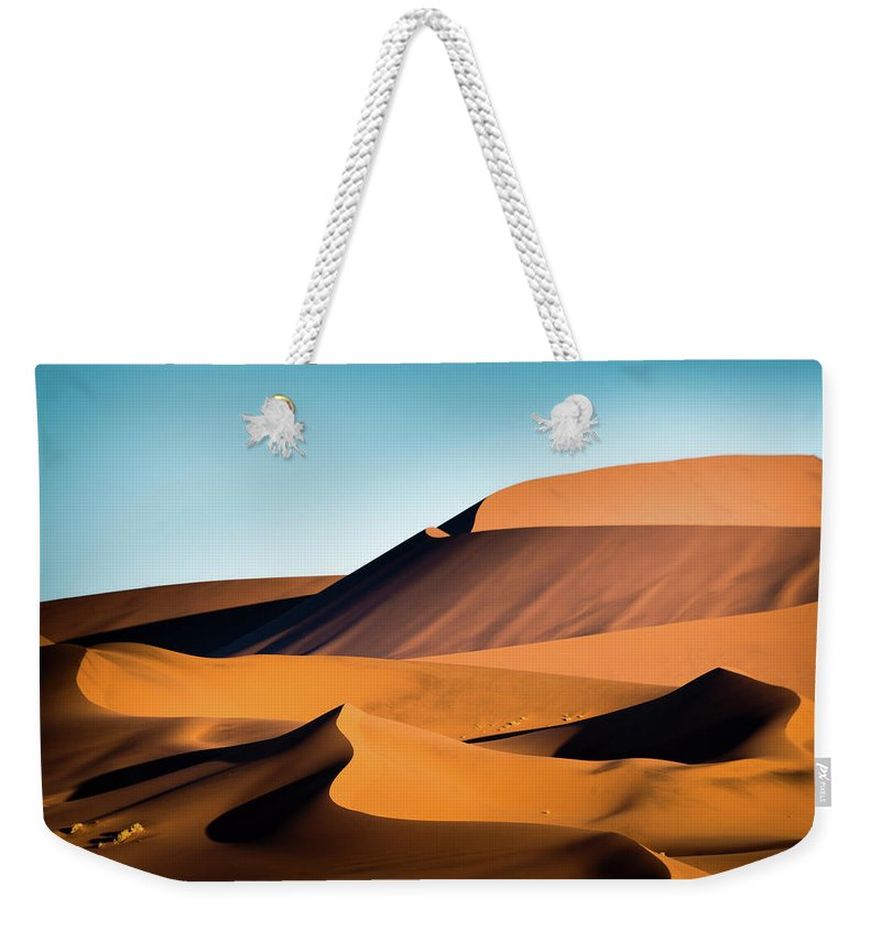 Sand Dune Weekender Tote Bag featuring the photograph The Red Sand Dunes In Namibia by José Gieskes Fotografie