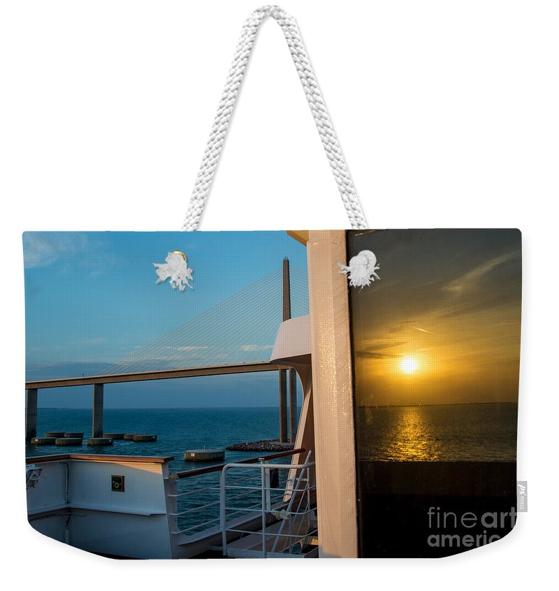 Cruise Weekender Tote Bag featuring the photograph The Reflection Of A Crossing Gold To Blue by Rene Triay Photography
