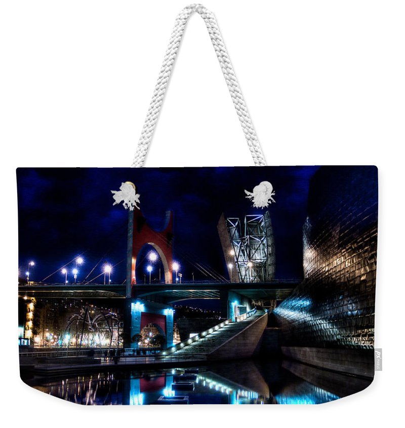 Guggenheim Museum Weekender Tote Bag featuring the photograph The Riverside Pool Of The Guggenheim Museum In Bilbao Spain by Weston Westmoreland