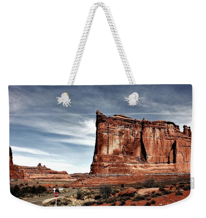 Arches Weekender Tote Bag featuring the photograph The Road Through Arches by Benjamin Yeager