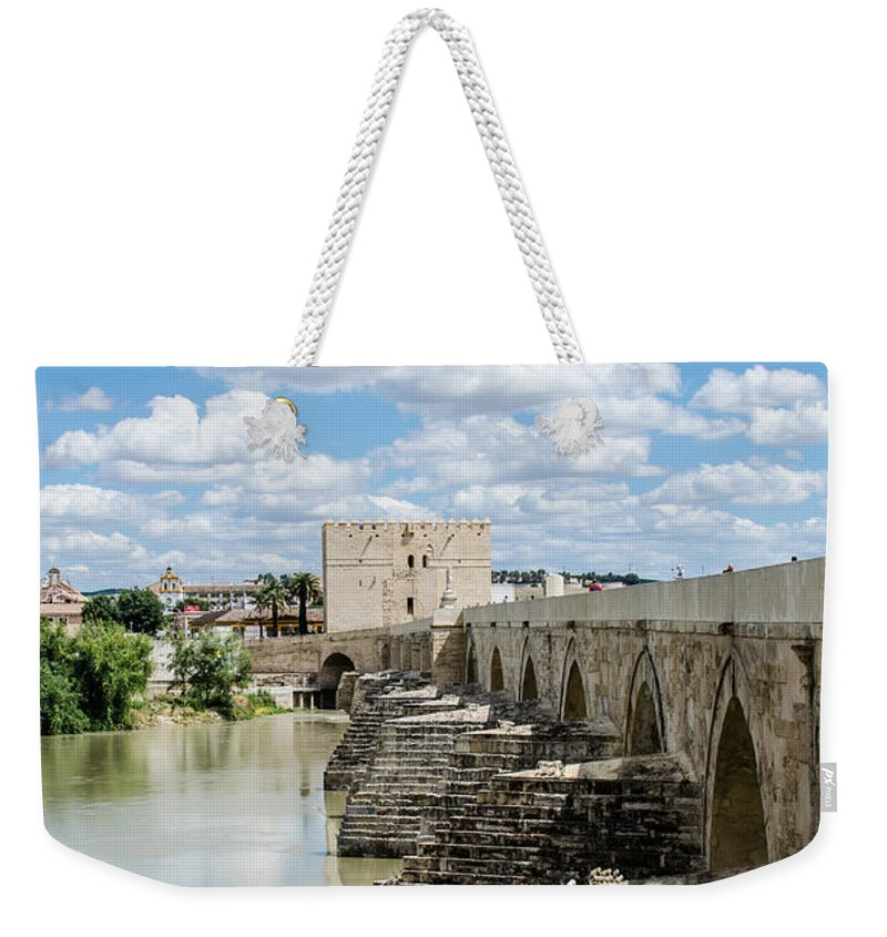 Roman Weekender Tote Bag featuring the photograph The Roman Bridge Of Cordoba by Andrea Mazzocchetti