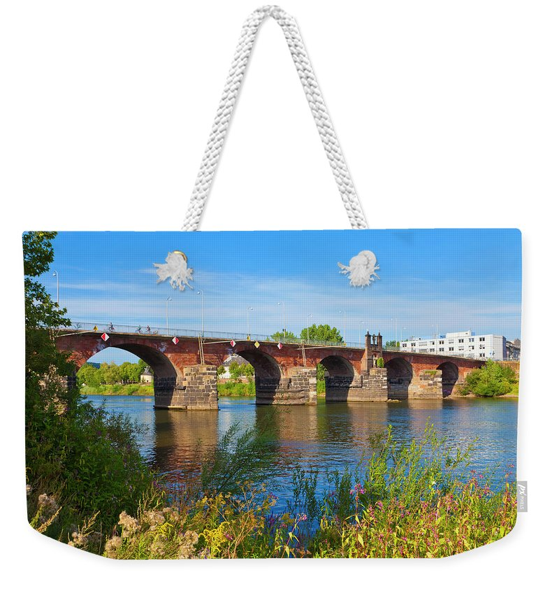 Roman Weekender Tote Bag featuring the photograph The Roman Bridge Over Mosel River In by Werner Dieterich