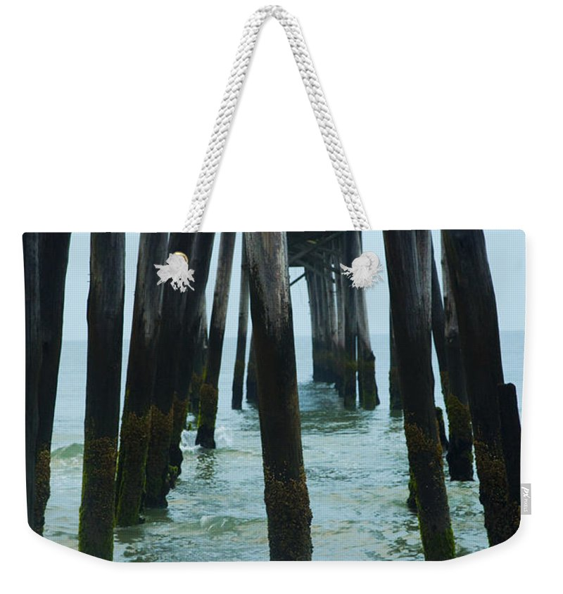 Ruins Weekender Tote Bag featuring the photograph The Ruins Of The 59th Street Pier by Bill Cannon