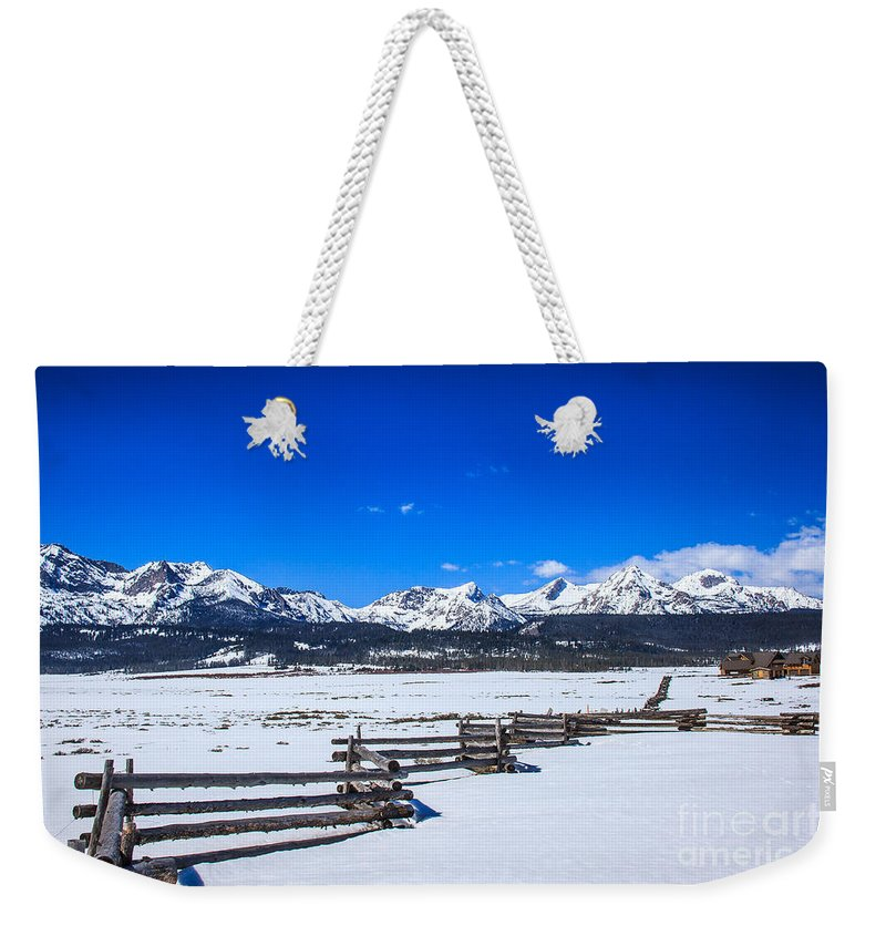 Rocky Mountains Weekender Tote Bag featuring the photograph The Sawtooth Mountains by Robert Bales