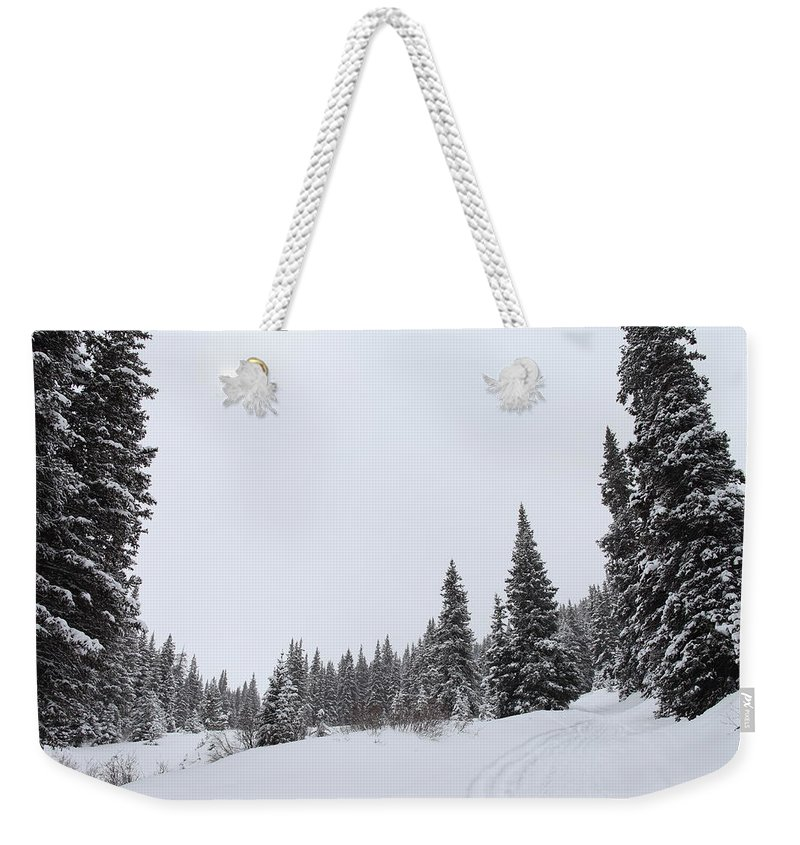 Colorado Weekender Tote Bag featuring the photograph The Season Of White by Eric Glaser