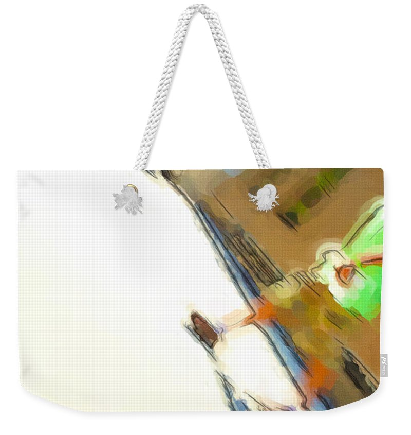 The Shadow Follows Weekender Tote Bag featuring the photograph The Shadow Follows by Karol Livote