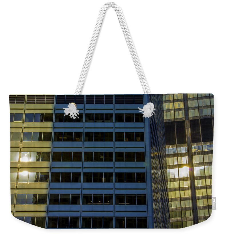 Weekender Tote Bag featuring the photograph The Shining by Raymond Kunst