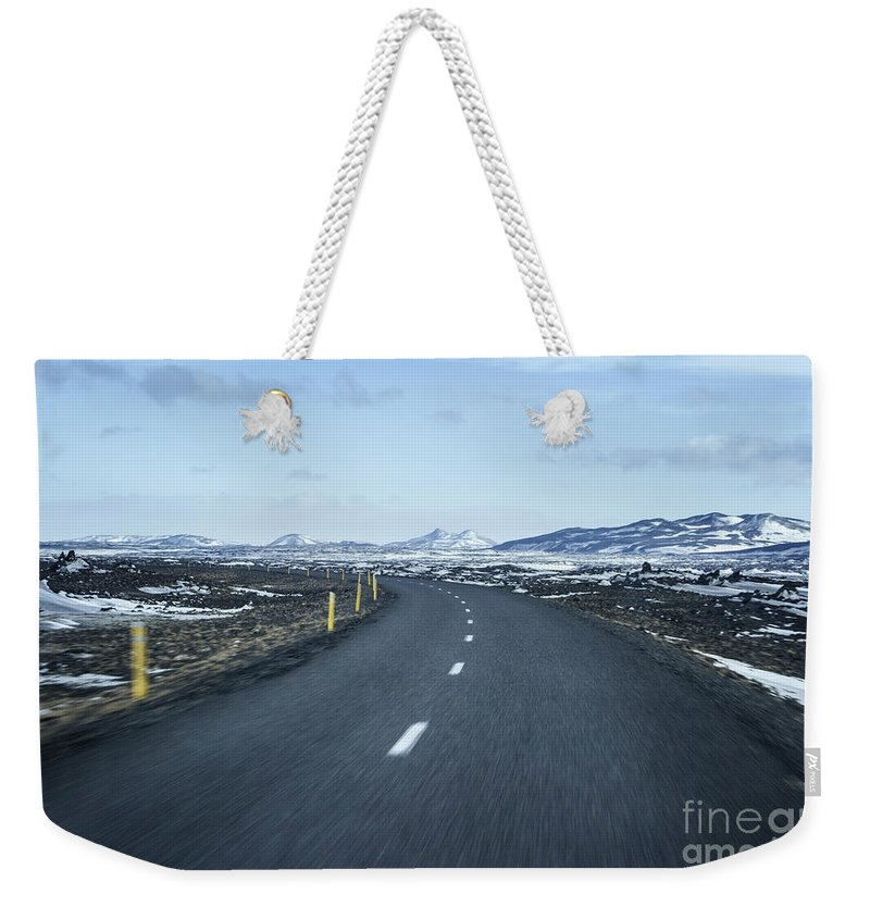 Iceland Weekender Tote Bag featuring the photograph The Speed I Need by Evelina Kremsdorf