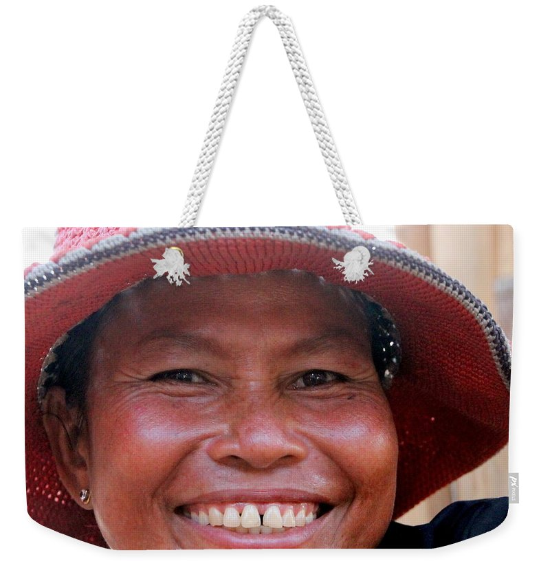 Woman Weekender Tote Bag featuring the photograph The Sticky Rice Lady by Laurel Talabere