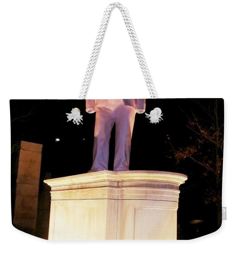 Weekender Tote Bag featuring the photograph The Suit At City Garden by Kelly Awad