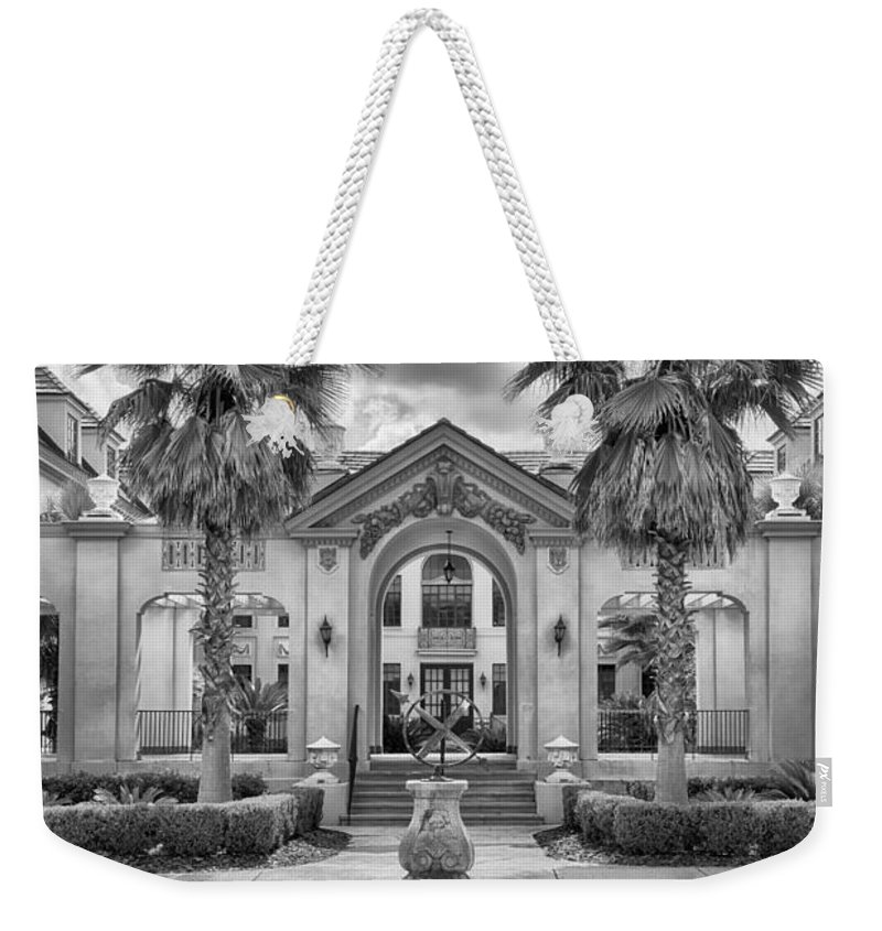 Weekender Tote Bag featuring the photograph The Thomas Center Gardens by Howard Salmon