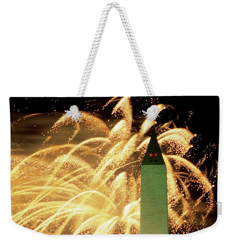 Firework Display Weekender Tote Bag featuring the photograph The Washington Monument And Fireworks by Hisham Ibrahim