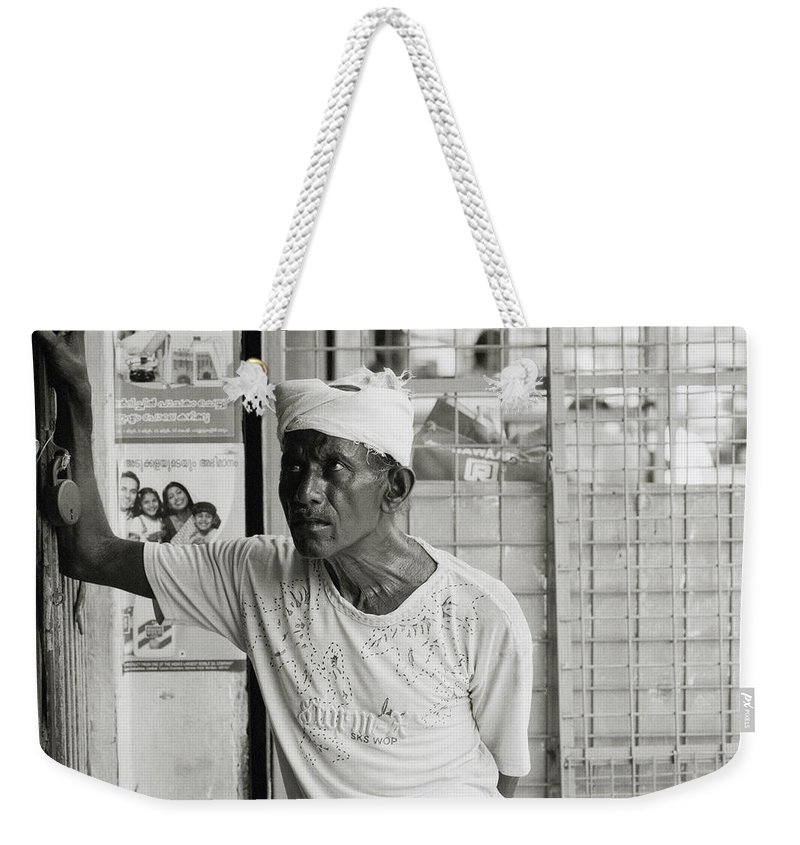 Worker Weekender Tote Bag featuring the photograph The Worker In Cochin by Shaun Higson