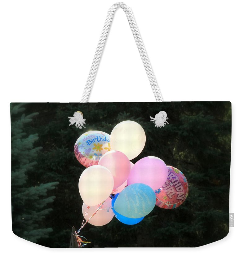 Float Weekender Tote Bag featuring the photograph They Are Floating by Valentino Visentini
