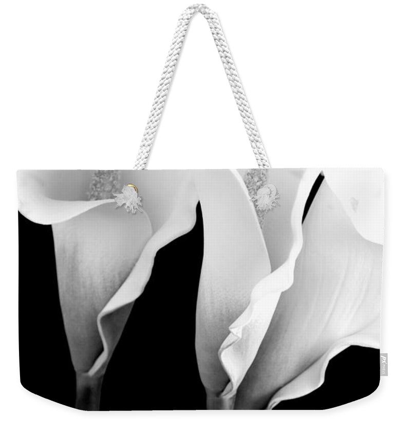 Calla Lily Weekender Tote Bag featuring the photograph Three Calla Lilies In Black And White by Mary Deal