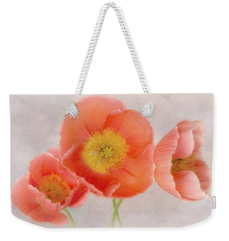 Poppies Weekender Tote Bag featuring the photograph Three Peach Poppies by David and Carol Kelly