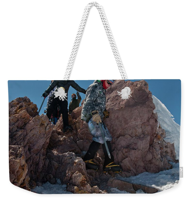 Young Man Weekender Tote Bag featuring the photograph Three People Climb Down Rocks by Beth Wald