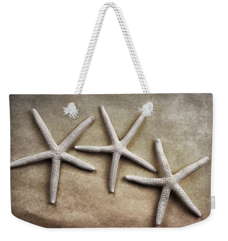 Starfish Weekender Tote Bag featuring the photograph Three Starfish by Carol Leigh
