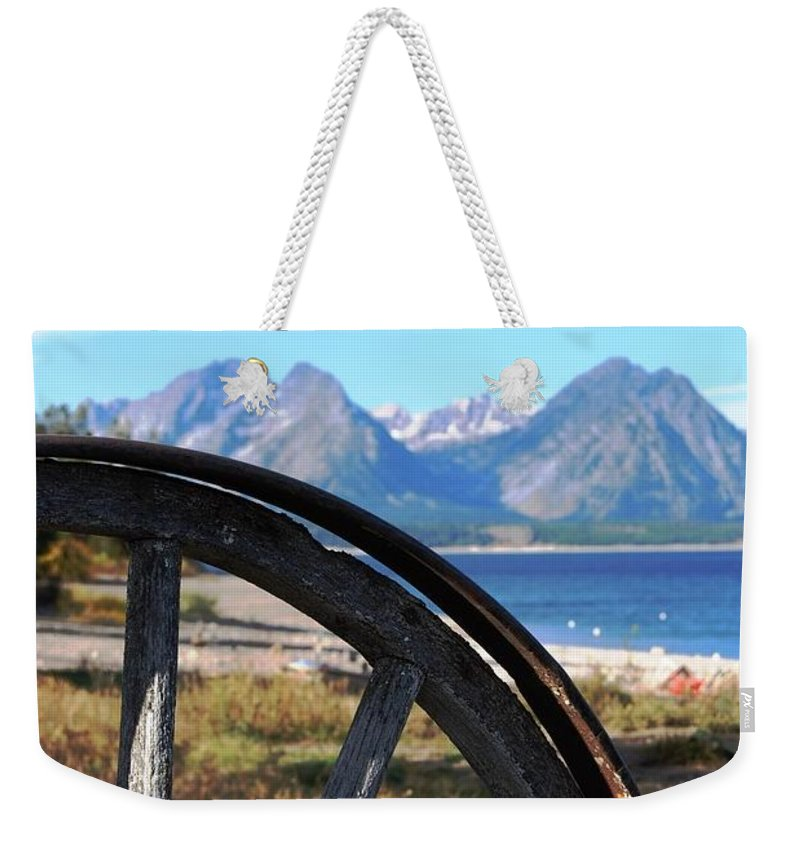 Landscape Weekender Tote Bag featuring the photograph Through The Wheel by Deanna Cagle