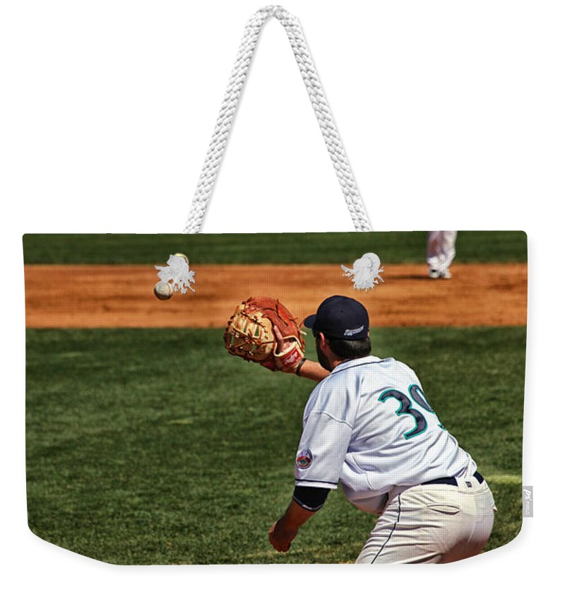 Baseball Weekender Tote Bag featuring the photograph Throw To First by Karol Livote