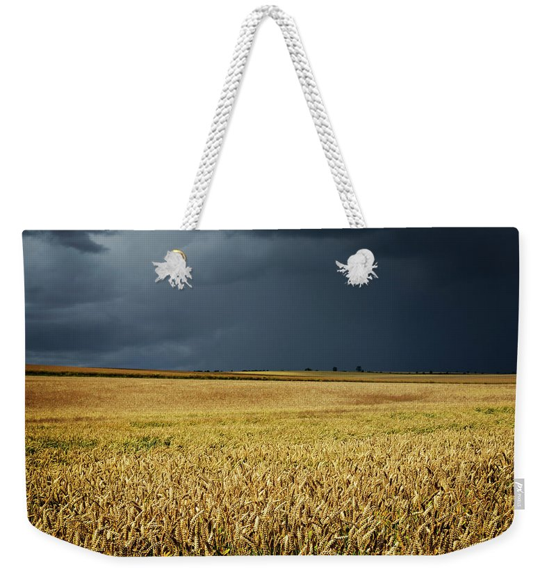 Scenics Weekender Tote Bag featuring the photograph Thunderstorm Clouds Over Wheat Field by Avtg