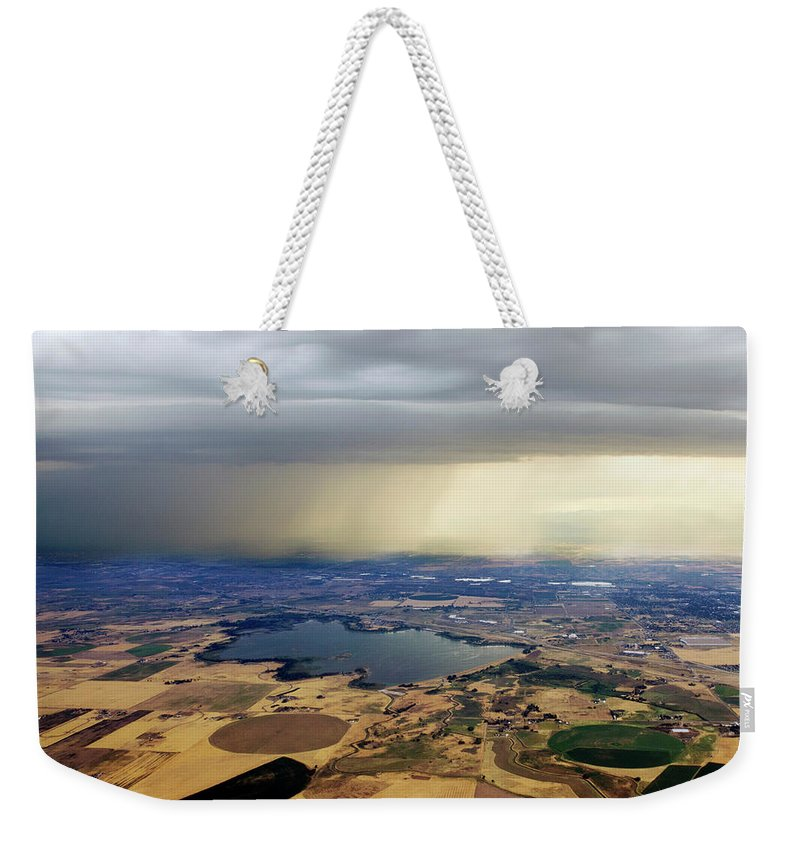 Tranquility Weekender Tote Bag featuring the photograph Thunderstorm Over Denver, Colerado by Gail Shotlander