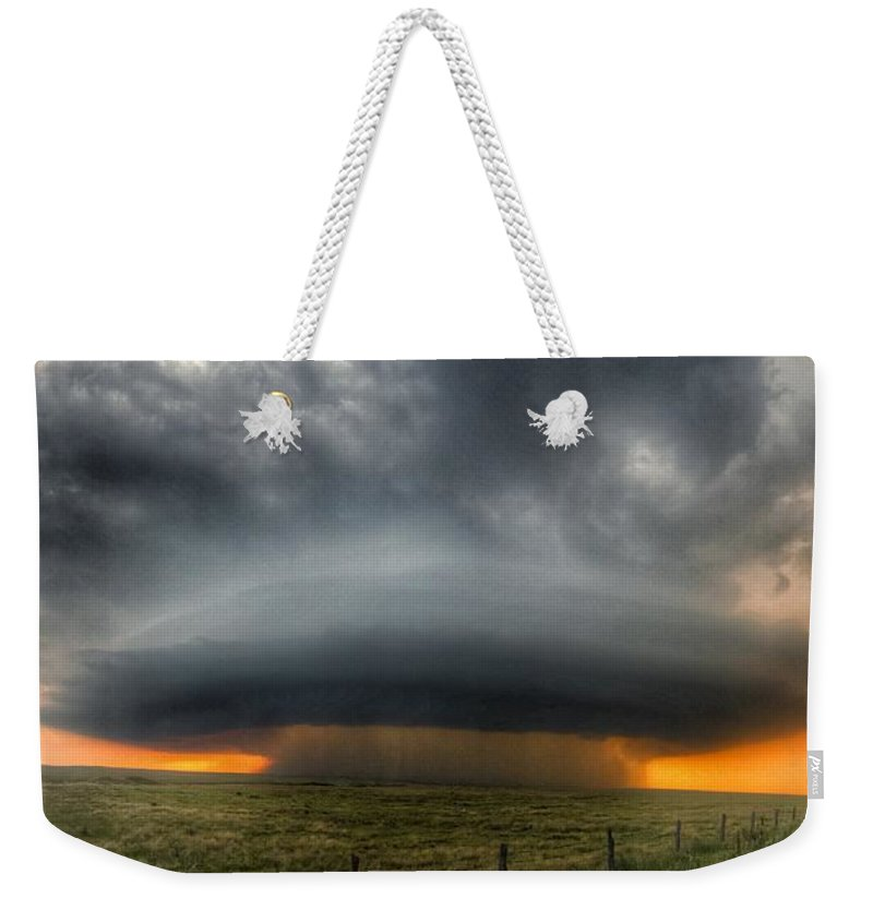 Problems Weekender Tote Bag featuring the photograph Thunderstorm Over Grassy Field by Brian Harrison / Eyeem