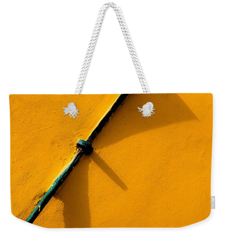 Tensor Weekender Tote Bag featuring the photograph Tightener by Edgar Laureano
