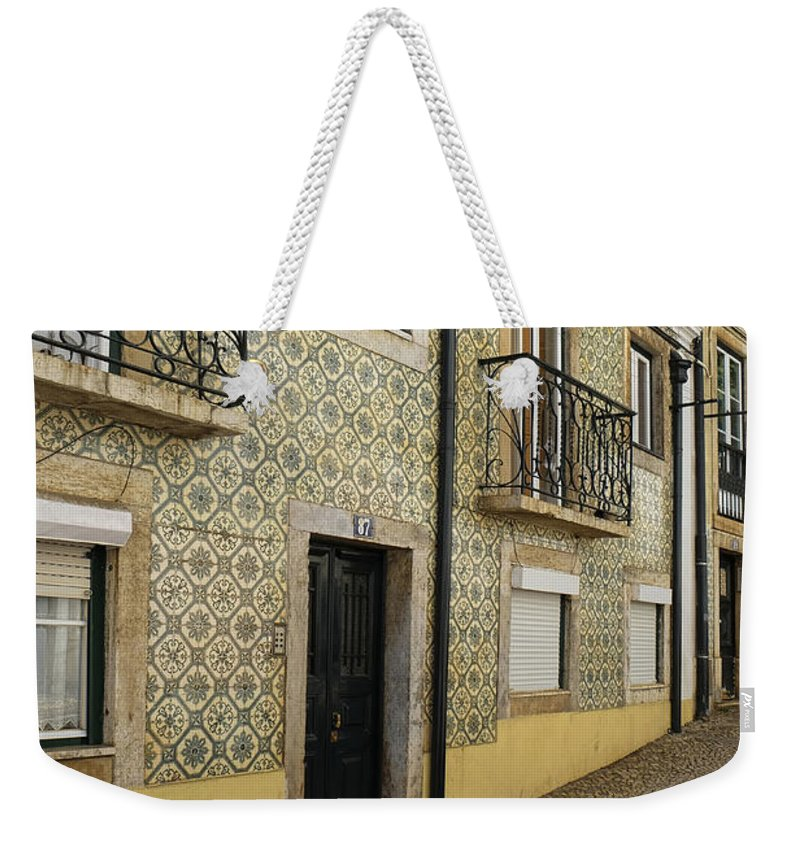 Lucinda Walter Weekender Tote Bag featuring the photograph Tile Walls Of Lisbon by Lucinda Walter