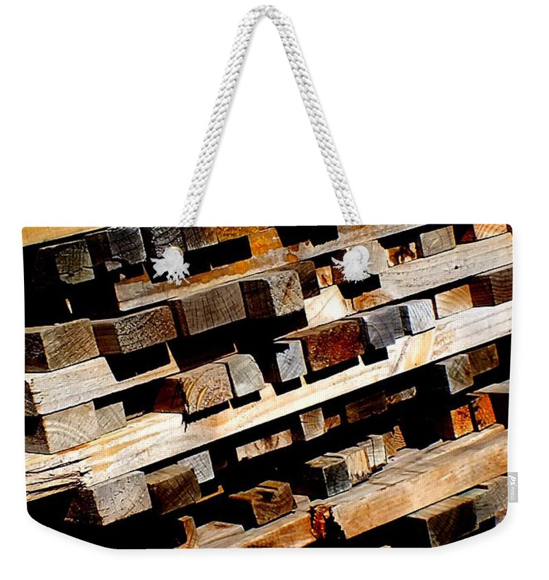 Hopper Weekender Tote Bag featuring the photograph Tilted by Guy Pettingell
