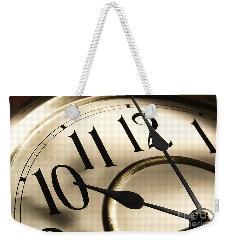 Clock Weekender Tote Bag featuring the photograph Time Goes By by Olivier Le Queinec