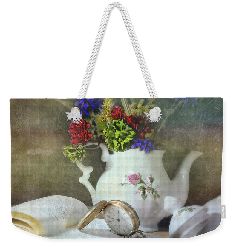 Still Life Weekender Tote Bag featuring the photograph Time In A Pocket by Diana Angstadt