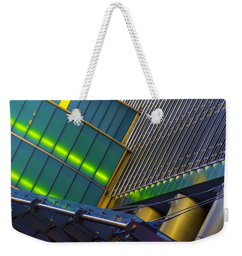 Weekender Tote Bag featuring the photograph Tin Pan Alley by Raymond Kunst