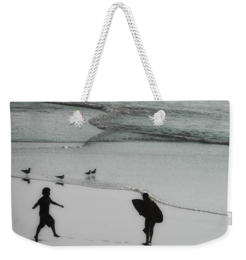 Surf Weekender Tote Bag featuring the photograph Tip Toe Through The Surf by Donna Blackhall