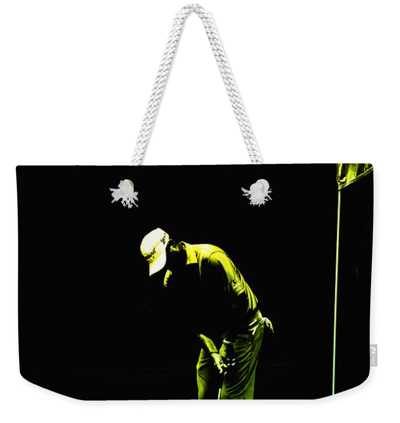 Golf Weekender Tote Bag featuring the photograph To Putt by Karol Livote