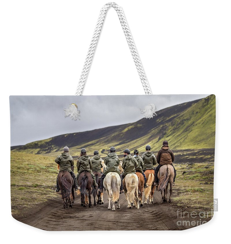 Landmannalaugar Weekender Tote Bag featuring the photograph To Ride The Paths Of Legions Unknown by Evelina Kremsdorf