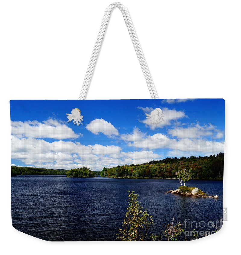 Lakes Weekender Tote Bag featuring the photograph To The Island And Back by Jeffery L Bowers