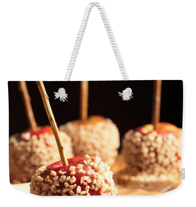 Toffee Weekender Tote Bag featuring the photograph Toffee Apples by Amanda Elwell