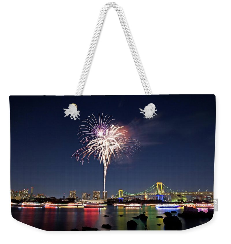 Firework Display Weekender Tote Bag featuring the photograph Tokyo Bay Fireworks by Photography By Zhangxun