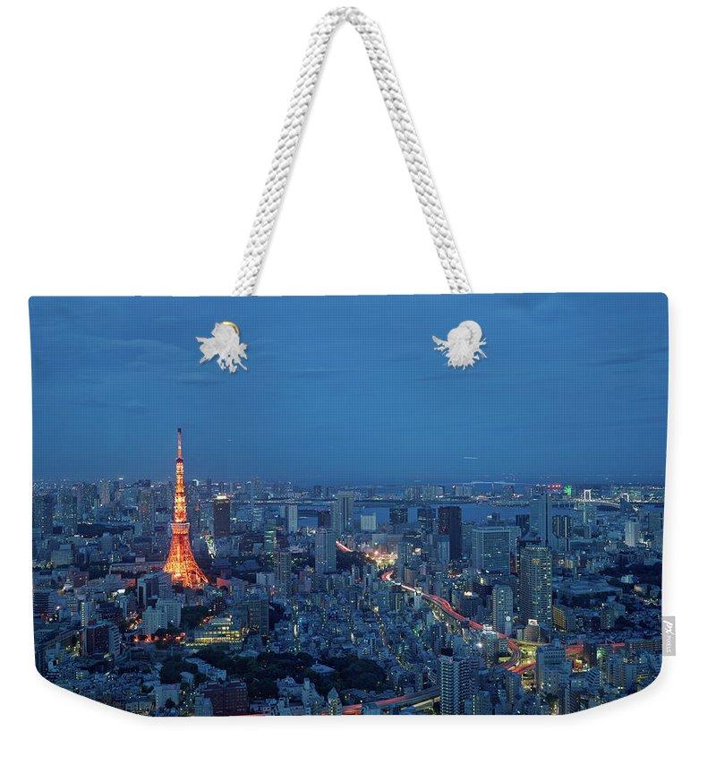 Tokyo Tower Weekender Tote Bag featuring the photograph Tokyo Skyline With Tokyo Tower Landmark by Yat Lee