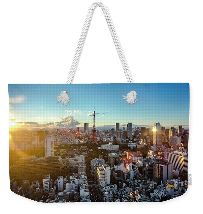 Tokyo Tower Weekender Tote Bag featuring the photograph Tokyo Tower After Raining by Panithan Fakseemuang