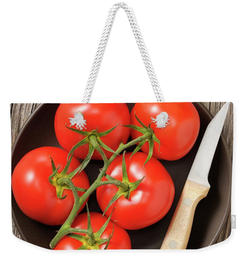 Kitchen Knife Weekender Tote Bag featuring the photograph Tomato by Riou