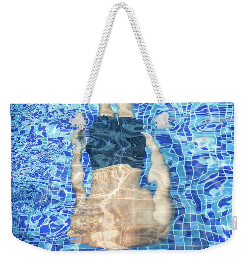 Underwater Weekender Tote Bag featuring the photograph Top View Of Man Diving by Jasmin Merdan